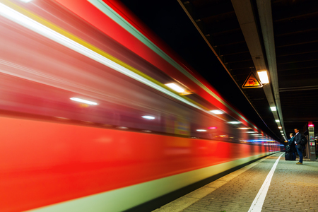 Cologne, Germany - March 15, 2017: night train of Deutsche Bahn with unidentified people. Deutsche Bahn is the 2nd-largest transport company in the world with about 2 billion passengers a year
