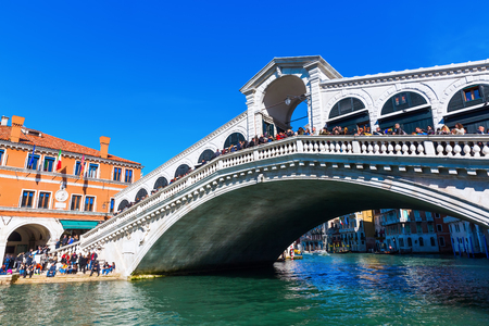 Venice, Italy - February 25, 2017: Rialto Bridge at the Grand Canal with unidentified people.