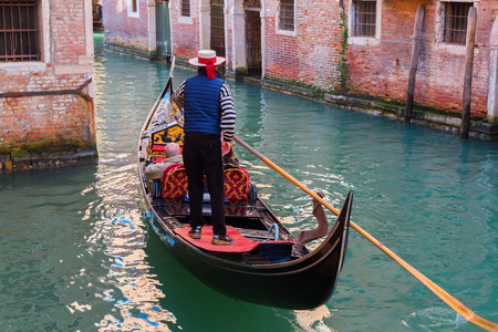 Venice, Italy - February 25, 2017: canal in Venice with gondolas and unidentified people. Venice is world renown for the beauty of its settings