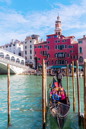 stakes: Venice, Italy - February 27, 2017: Rialto Bridge at the Grand Canale with unidentified people. Editorial