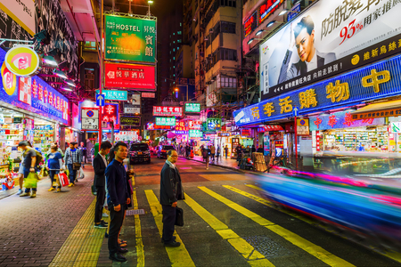 Hong Kong, Hong Kong - March 14, 2017: shopping street with illuminated advertisings and unidentified people at night. Hong Kong ranks as the worlds 4th most densely populated sovereign state
