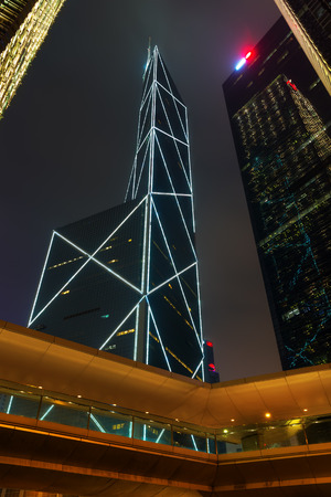 Hong Kong, Hong Kong - March 12, 2017: night cityscape with skyscrapers in Hong Kong central district. Hong Kong is one of worlds most significant financial centres, 4th most densely populated state