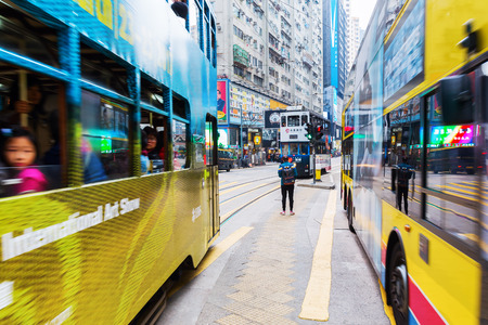 Hong Kong, Hong Kong - March 11, 2017: busy traffic on Kings Road in Hong Kong with unidentified people. Kings Road is a major east-west street along the Hong Kong Island Editorial