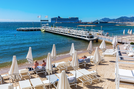 well known: Cannes, France - August 05, 2016: city beach at the Croisette in Cannes with unidentified people. Cannes is well known for its association with the rich and famous, and the Cannes Film Festival Editorial