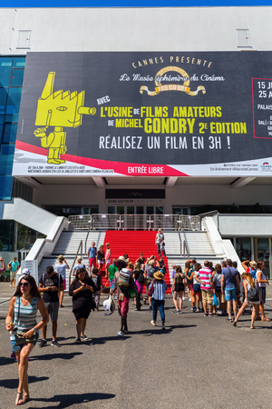 palais: Cannes, France - August 05, 2016: Palais des Festivals et des Congres with unidentified people. It is a convention center in Cannes, the venue for the Cannes Film Festival. The building opened in 1982 Editorial