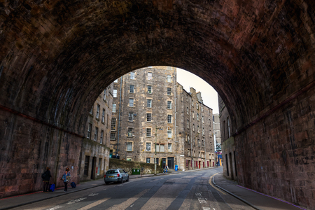 Edinburgh, UK - September 09, 2016: tunnel of the Regents Bridge with unidentified people. The bridge was designed by Archibald Elliot and completed in 1819, it carries Waterloo Place over Calton Road