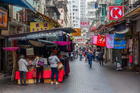 Hong Kong, Hong Kong - March 10, 2017: market street in Kowloon, Hong Kong, with unidentified people. Hong Kong is one of worlds most significant financial centres, 4th most densely populated state