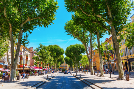 Aix-en-Provence, France - July 27, 2016: street Cours Mirabeau with unidentified people. 440 meters long and 42 meters wide, the Cours Mirabeau is one of the most popular and lively places in the town Editorial
