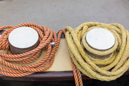 bollards: picture of bollards with mooring ropes at a harbor