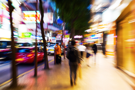 street scene in Hong Kong at night with creative zoom effect Stock Photo