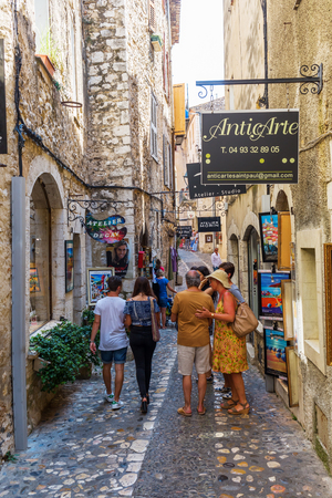 Saint-Paul-de-Vence, France - August 04, 2016: shopping alley with unidentified people. The town is one of the oldest medieval ones on the French Riviera, also well known for its art galleries