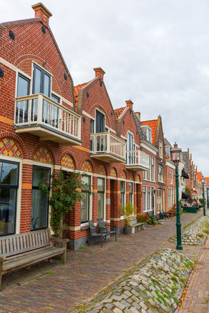 Enkhuizen, Netherlands - October 09, 2016: old row houses in Enkhuizen, Netherlands, with unidentified people. Enkhuizen has today one of the largest marinas in the Netherlands