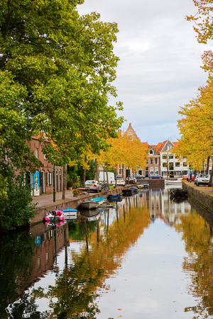 markermeer: Hoorn, Netherlands - October 08, 2016: canal with autumn colored trees in Hoorn. Hoorn is a harbor town at the Markermeer, dating back to the 12th century Editorial