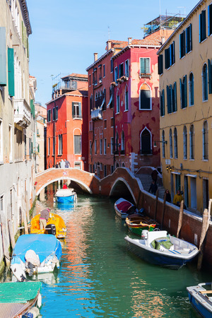 Venice, Italy - February 25, 2017: typical canal in Venice with unidentified people. Venice is world renown for the beauty of its settings, a part is listed under UNESCO world heritage sites Editorial