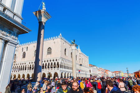 Venice, Italy - February 25, 2017: crowds of unidentified people at the Piazzetta in Venice. Venice is world renown for the beauty of its settings, a part is listed under UNESCO world heritage sites Editorial