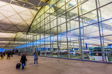 Hong Kong, Hong Kong - March 15, 2017: front of Hong Kong Airport with unidentified people. In 2015, HKIA handled 68.5 mio passengers, making it the 8th busiest airport worldwide by passenger traffic