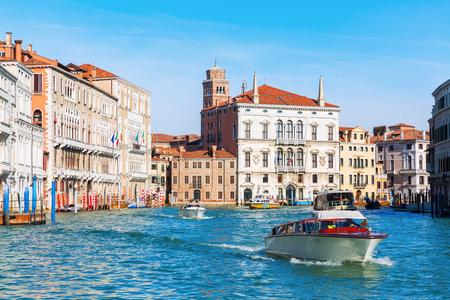 Venice, Italy - February 26, 2017: scene with unidentified person at the Grand Canal. Venice is world renown for the beauty of its settings, a part is listed under UNESCO world heritage sites