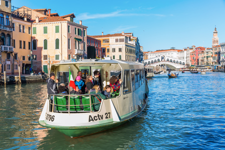Venice, Italy - February 25, 2017: scene with unidentified person at the Grand Canal. Venice is world renown for the beauty of its settings, a part is listed under UNESCO world heritage sites