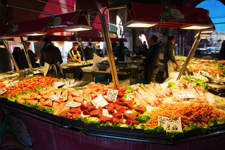 Venice, Italy - February 25, 2017: market scene at the Rialto Street Market in Venice with unidentified people. Venice is world renown for the beauty of its settings, a part is UNESCO listed