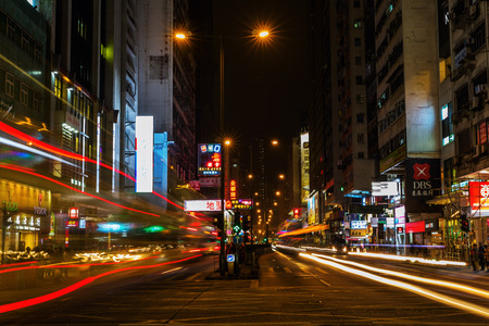 Hong Kong, Hong Kong - March 14, 2017: street scene at night in Kowloon, with unidentified people. HK is one of worlds most significant financial centres and the 4th most densely populated state