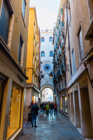 Venice, Italy - February 25, 2017: side street from St. Marks Square in Venice with unidentified people. Venice is world renown for the beauty of its settings, a part is UNESCO listed