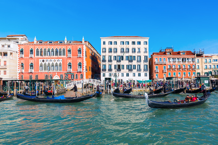 Venice, Italy - February 26, 2017: cityscape viewed from lagoon, with unidentified people. Venice is world renown for the beauty of its settings, a part is listed under UNESCO world heritage sites