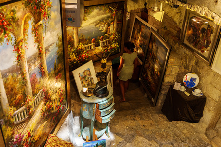 Saint-Paul-de-Vence, France - August 04, 2016: art shop with unidentified person. The town is one of the oldest medieval ones on the French Riviera, also well known for its art galleries Editorial