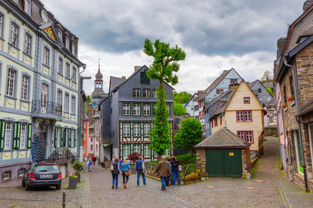 Monschau, Germany - May 21, 2017: cityscape of Monschau with unidentified people. The historic town center has many half-timbered houses and narrow streets remained nearly unchanged for 300 years Editorial