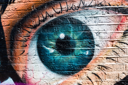 London, UK - June 15, 2016: street art in London. Street art has moved from the beginnings of graffiti and vandalism to new modes where artists work to bring messages, or just beauty, to an audience Editorial