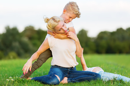 rollick: picture of a woman who romps with her son on the grass
