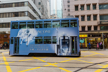 Hong Kong, Hong Kong - March 09, 2017: HK tramway on HK Island with unidentified people. The Trams in HK have not only been a commuter transport for over 110 years, also a major tourist attraction Editorial