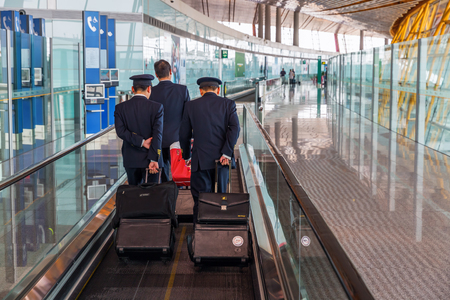 Hong Kong, Hong Kong - March 15, 2017: inside view of HK Airport with unidentified people. In 2015, HKIA handled 68.5 mio passengers, making it the 8th busiest airport worldwide by passenger traffic Publikacyjne