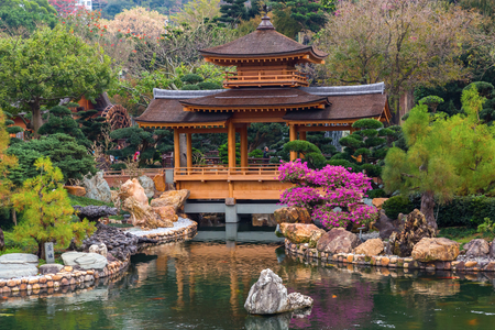 tang: Hong Kong, Hong Kong - March 11, 2017: Nan Lian Garden Pavilion of Absolute Perfection with unidentified people. Its a Chinese Classical Garden in Diamond Hill, HK, designed in Tang Dynasty style Editorial
