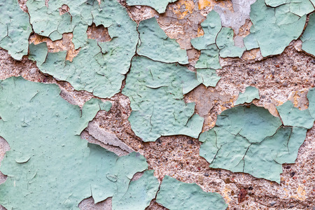 background texture of an old wall plaster with flaking off paint