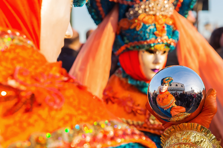 Venice, Italy - February 25, 2017: unidentified disguised people at the Carnival of Venice. The Carnival of Venice is an annual festival, world famous for its elaborate masks.