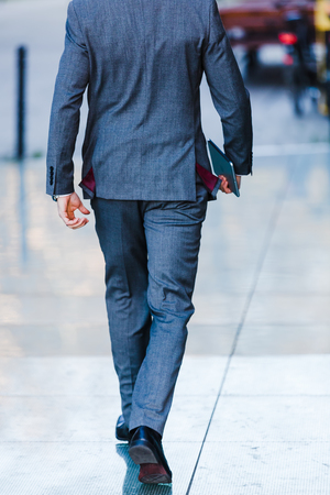 rear view of a businessman walking in the city