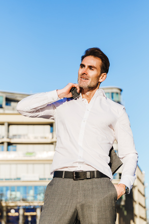 picture of a businessman who throws his jacket over the shoulder