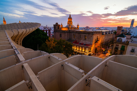 Seville, Spain - November 13, 2018: Metropolitan Parasol with unidentified people at night. It is a wooden structure designed by Juergen Mayer, with dimensions 150 by 70 meters and 26 meters high