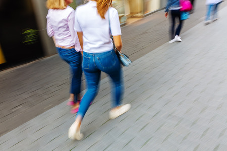 picture with motion blur effect walking in the pedestrian zone of a city