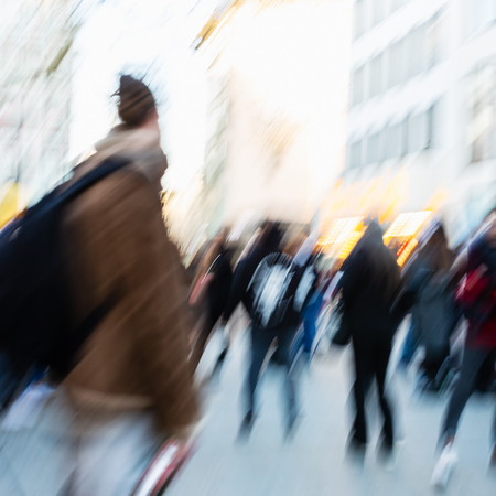 picture of people walking on a city street, with camera made motion blur effect
