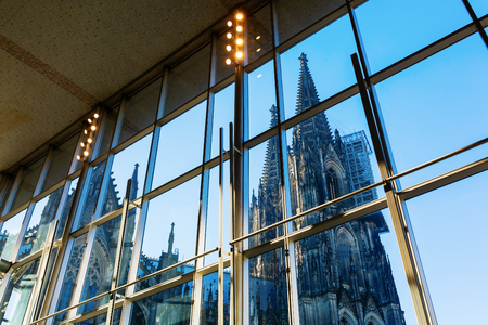 Cologne Cathedral viewed through the glass front of the Main Station, Cologne, Germany