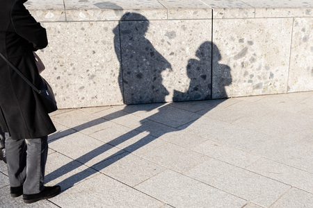 picture of the shadows of two women on a wall