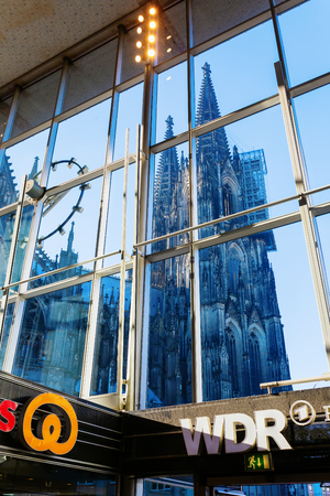 Cologne, Germany - February 16, 2019: view from inside the Main Station to the Cologne Cathedral. With 280,000 travelers daily it is one of the busiest stations in Germany