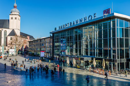 Cologne, Germany - February 16, 2019: forecourt of the main station of cologne, with unidentified people. With daily 280,000 travelers the station is one of the busiest stations in Germany