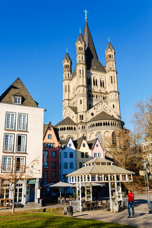 Cologne, Germany - February 16, 2019: Fish Market with St. Martin Church, with unidentified people. For the most picturesque fish market is the embodiment of the historical old town of cologne Publikacyjne