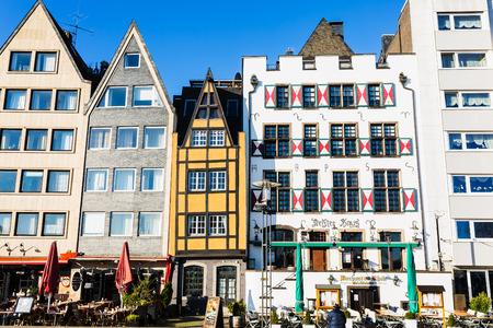 Cologne, Germany - February 16, 2019: old gable houses in the old town of cologne, with unidentified people. It is the largest city of Germans most populous federal state of North Rhine-Westphalia Publikacyjne