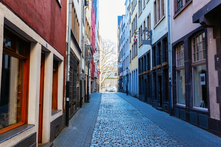 Cologne, Germany - February 16, 2019: narrow alley at the historic old town of Cologne. It is the largest city of Germans most populous federal state of North Rhine-Westphalia