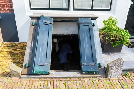 antique coal cellar door at an old house in Veere, Netherlands