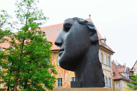 Bamberg, Germany - June 14, 2019: head sculpture in Bamberg, Bavaria. The sculpture was designed by world renowned sculptor Igor Mitoraj, erected 1987