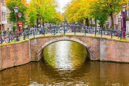 view of a typical canal with bridge in Amsterdam, Netherlands